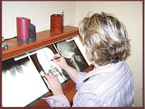 Dr. Christensen Studies X-Rays for a Precise Realignment of the Spine